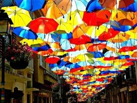colourful-floating-umbrella-installation-agueda-portugal-art-festival-agitagueda-studio-ivotavares-patricia-almeida-photographer-the-flying-tortoise-001